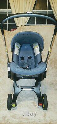 Doona Infant Car Seat/Stroller with LATCH Base gently used GUC